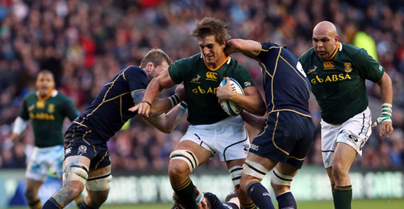 Ryan Grant of Scotland tackles Eben Etzebeth